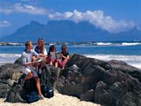 studenti na pláži, Cape Town